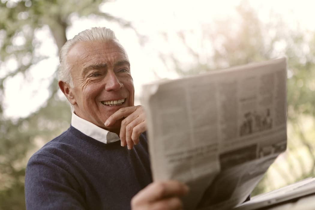 Man reading a newspaper.